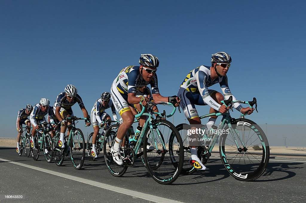 Rob Ruijgh and Barry Markus of the Netherlands lead the Vacansoleil-DCM team during stage two of the 2013 Tour of Qatar, a 14km Team Time Trial, along Al Rufaa Street on February 4, 2013 in Doha, Qatar.