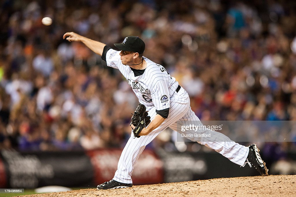 Rob Scahill #62 of the Colorado Rockies pitches in the sixth inning f a game against the Cincinnati Reds at Coors Field on August 31, 2013 in Denver, Colorado. The Reds beat the Rockies 8-3.