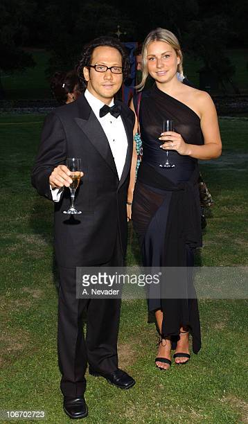 Rob Schneider and guest during The 22nd Annual Napa Valley Wine Auction Cirque du Vin Revelry in the Vineyards at Meadowood Napa Valley in St Helena...