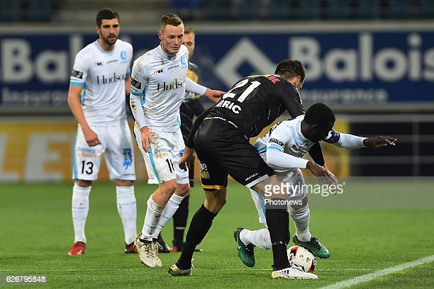 Rob Schoofs midfielder of KAA Gent, Nana Asare defender of KAA Gent and Marko Miric of sporting lokeren in a fight for the ball during the Croky Cup...