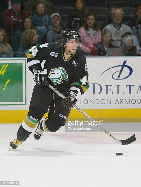 Rob Schremp of the London Knights looks to make a play with the puck against the Owen Sound Attack during an OHL game at the John Labatt Center on...