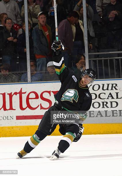 Rob Schremp of the London Knights skates back on the ice as he is named one of three stars of the game after defeating the Windsor Spitfires in a...