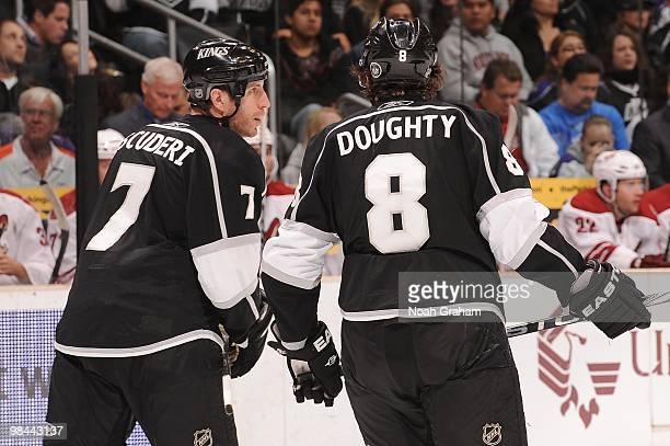 Rob Scuderi and Drew Doughty of the Los Angeles Kings talk on the ice during a break in the action against the Phoenix Coyotes on April 8 2010 at...