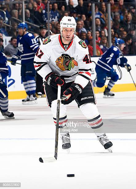 Rob Scuderi of the Chicago Blackhawks controls the puck against the Toronto Maple Leafs during game action on January15 2016 at Air Canada Centre in...