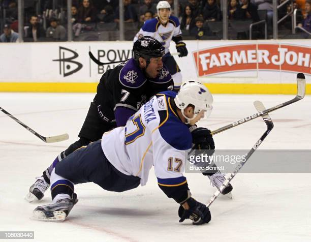 Rob Scuderi of the Los Angeles Kings hits Vladimir Sobotka of the St Louis Blues at the Staples Center on January 13 2011 in Los Angeles California