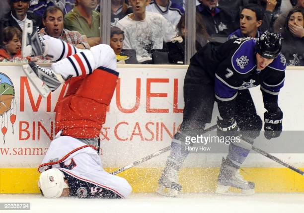 Rob Scuderi of the Los Angeles Kings knocks Jason Chimera of the Columbus Blue Jackets to the ice with a bodycheck during the first period at the...