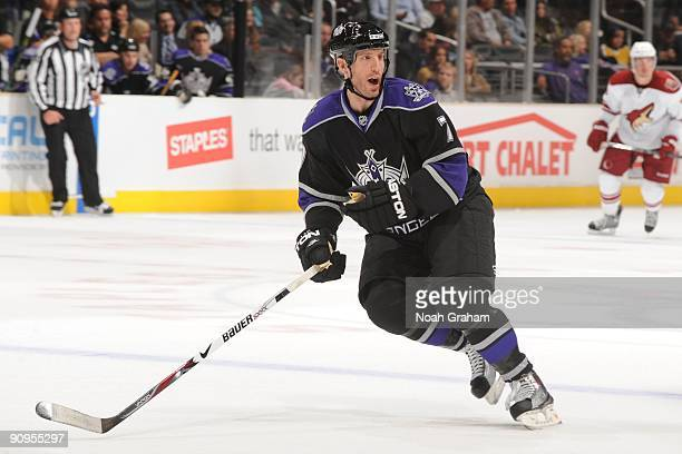 Rob Scuderi of the Los Angeles Kings looks for the puck against the Phoenix Coyotes on September 15 2009 at Staples Center in Los Angeles California