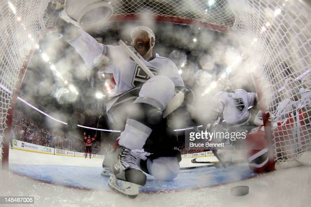 Rob Scuderi of the Los Angeles Kings reacts after Zach Parise of the New Jersey Devils directs the puck into the goal resulting in a disallowed goal...