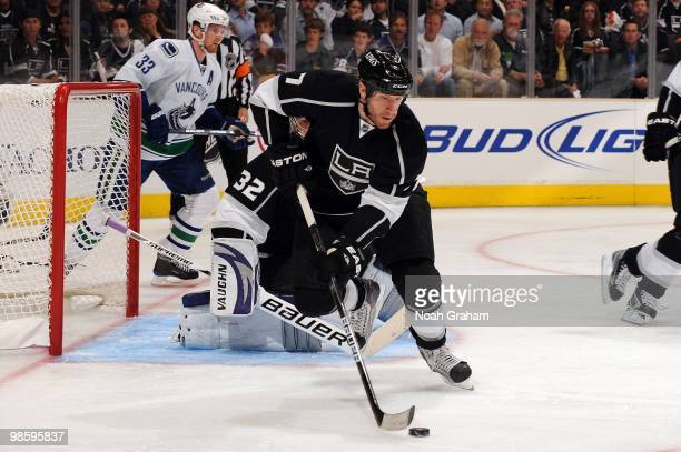 Rob Scuderi of the Los Angeles Kings skates with the puck against the Vancouver Canucks in Game Three of the Western Conference Quarterfinals during...