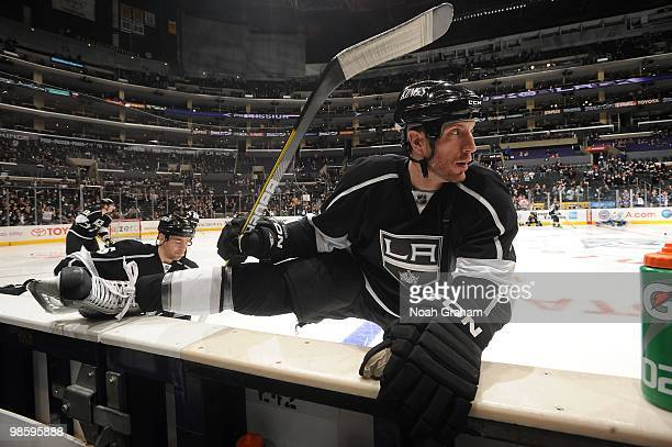 Rob Scuderi of the Los Angeles Kings stretches prior to taking on the Vancouver Canucks in Game Three of the Western Conference Quarterfinals during...