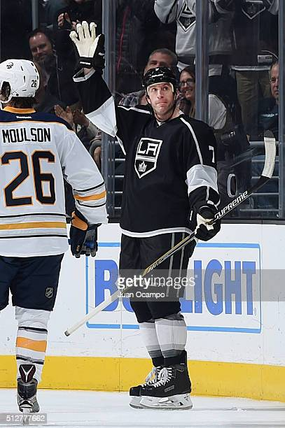 Rob Scuderi of the Los Angeles Kings waves to the crowd during the game against the Buffalo Sabres on February 27 2016 at Staples Center in Los...