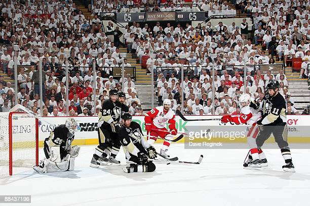 Rob Scuderi of the Pittsburgh Penguins blocks a shot late in the third period as goaltender MarcAndre Fleury Jordan Staal Matt Cooke and Mark Eaton...