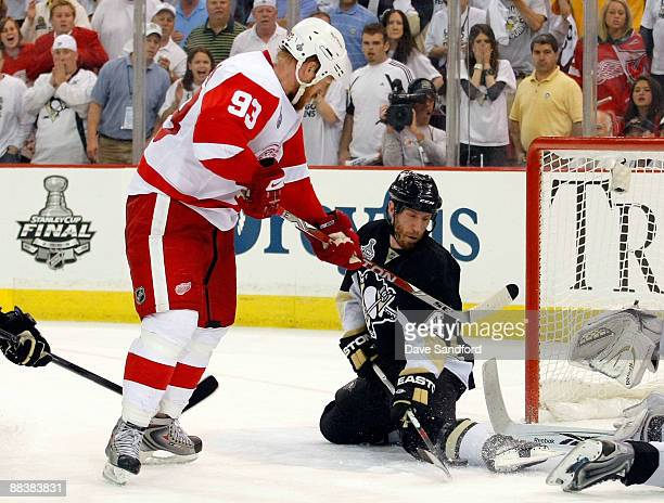 Rob Scuderi of the Pittsburgh Penguins blocks a shot on goal with his leg by Johan Franzen of the Detroit Red Wings in the last minute of the third...