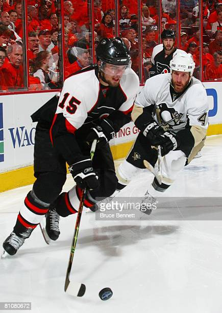 Rob Scuderi of the Pittsburgh Penguins chases Joffrey Lupul of the Philadelphia Flyers during game three of the Eastern Conference Finals of the 2008...