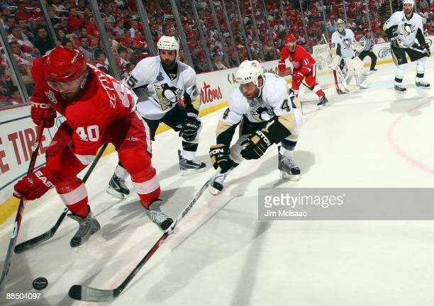 Rob Scuderi of the Pittsburgh Penguins defends against Henrik Zetterberg of the Detroit Red Wings during Game Seven of the 2009 NHL Stanley Cup...