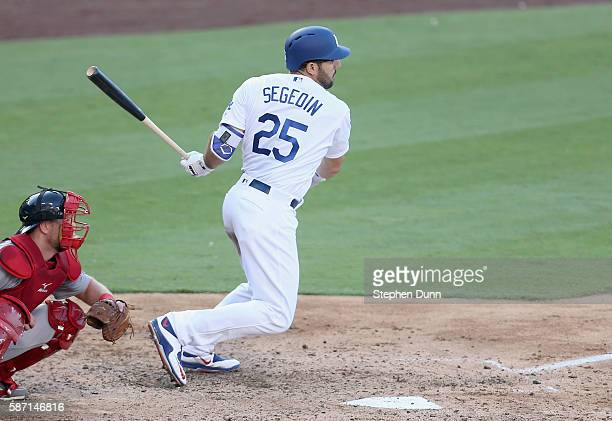 Rob Segedin of the Los Angeles Dodgers hits a two run single in the fifth inning against the Boston Red Sox at Dodger Stadium on August 7 2016 in Los...