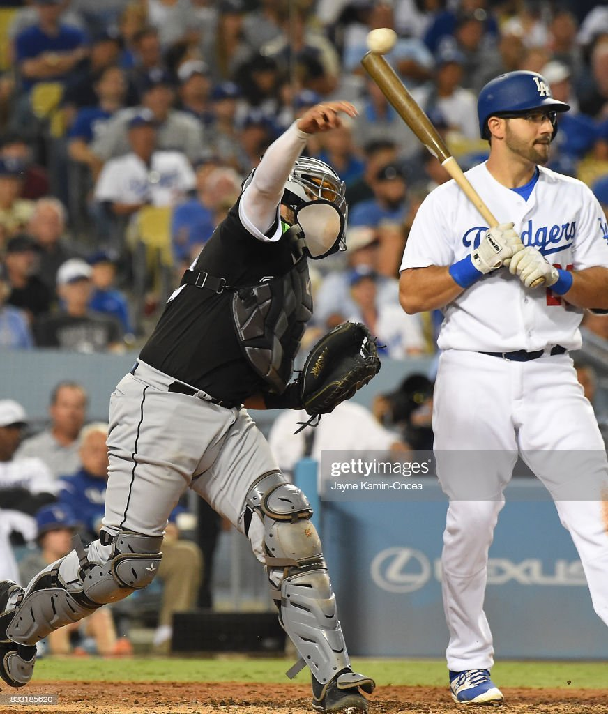 Rob Segedin #25 of the Los Angeles Dodgers looks on as Omar Narvaez #38 of the Chicago White Sox throws out Yasiel Puig #66 of the Los Angeles Dodgers on a steal attempt in the fifth inning of the game at Dodger Stadium on August 16, 2017 in Los Angeles, California.