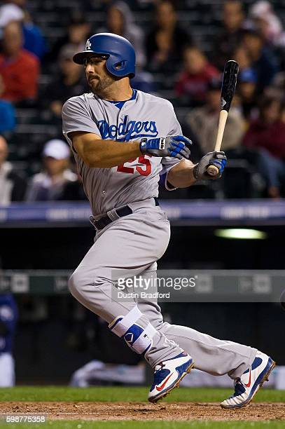 Rob Segedin of the Los Angeles Dodgers singles in the fourth inning of a game against the Colorado Rockies at Coors Field on August 29 2016 in Denver...