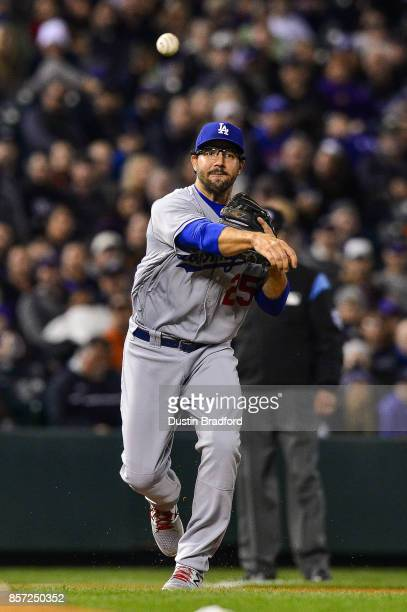 Rob Segedin of the Los Angeles Dodgers throws across the diamond for an out against the Colorado Rockies at Coors Field on September 29 2017 in...