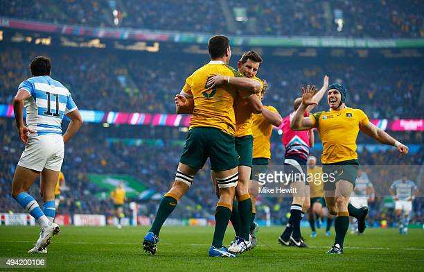 Rob Simmons celebrates with Bernard Foley of Australia after scoring the opening try during the 2015 Rugby World Cup Semi Final match between...