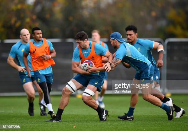 Rob Simmons of Australia is tackled by Billy Meakes of Australia during a training session at the Lensbury Hotel on November 16 2017 in London England