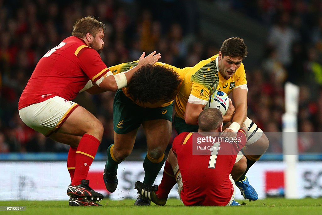Rob Simmons of Australia is tackled by Paul James of Wales during the 2015 Rugby World Cup Pool A match between Australia and Wales at Twickenham Stadium on October 10, 2015 in London, United Kingdom.