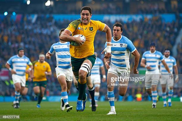 Rob Simmons of Australia races through to score the opening try during the 2015 Rugby World Cup Semi Final match between Argentina and Australia at...