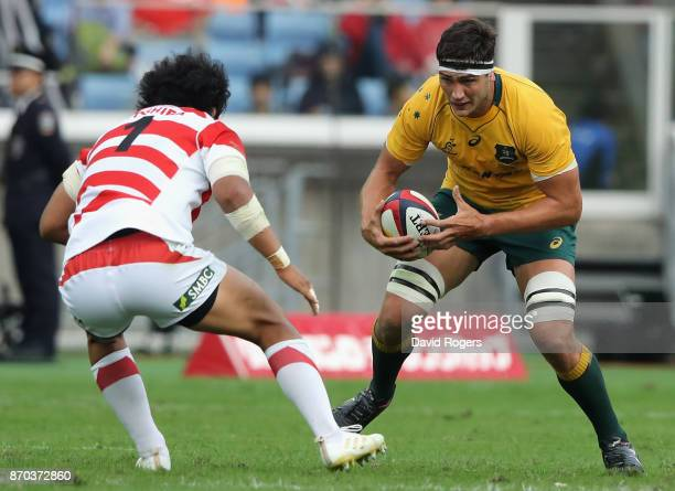 Rob Simmons of Australia takes on Keita Inagaki during the rugby union international match between Japan and Australia Wallabies at Nissan Stadium on...