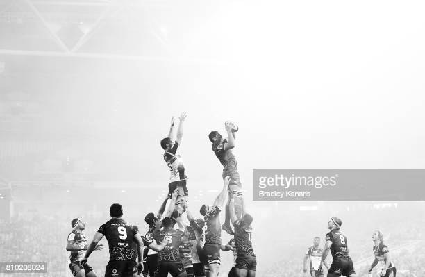 Rob Simmons of the Reds competes at the lineout as a blanket of fog can be seen during the round 16 Super Rugby match between the Reds and the...