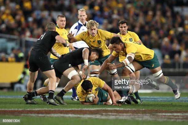 Rob Simmons of the Wallabies is tackled during The Rugby Championship Bledisloe Cup match between the Australian Wallabies and the New Zealand All...