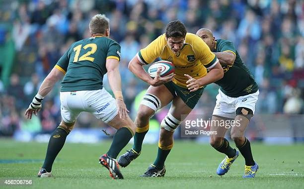 Rob Simmons of the Wallabies takes on Jean de Villiers and Cornal Hendricks during The Rugby Championship match between the South African Springboks...