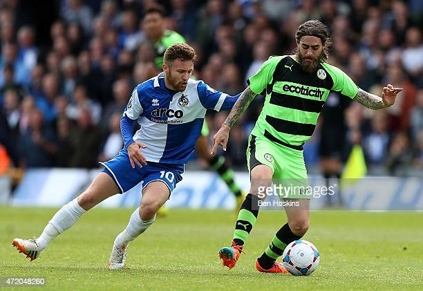 Rob Sinclair of Forest green holds off pressure from Matty Taylor of Bristol during the Vanarama Football Conference League Play Off Semi Final...
