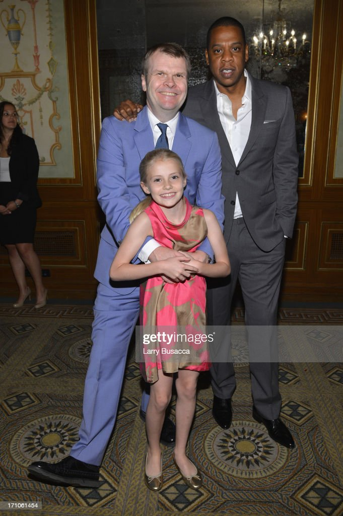 Rob Stringer and his daughter Florence pose with Jay-Z at a luncheon honoring Rob Stringer as UJA-Federation of New York Music Visionary of 2013 at The Pierre Hotel on June 21, 2013 in New York City.