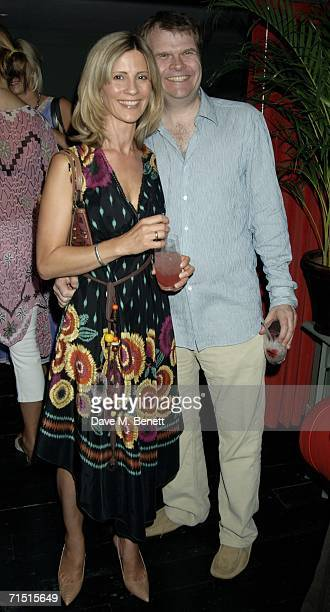 Rob Stringer and Julia Carling attend the opening party of High Road House at the new club July 25 2006 in London England