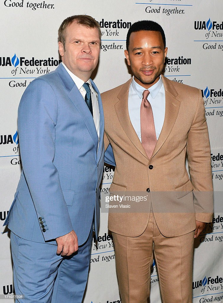 Rob Stringer (L), Chairman of the Columbia Records and singer/songwriter John Legend attend UJA-Federation Of New York Music Visionary Of The Year Award Luncheon at The Pierre Hotel on June 21, 2013 in New York City.