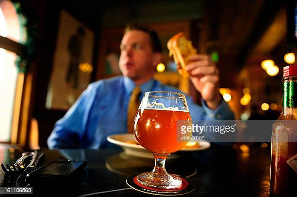 Rob Stuart of Denver having lunch and a glass of Orville Belgian Style Ale at the Wynkoop Brewing Co in downtown Denver Wynkoop and Breckenridge...