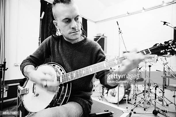 Rob 'The Bass Thing' Jones , of English pop group The Wonder Stuff, playing a banjo at Rockfield Studios, near Monmouth in Wales, December 1989. The...