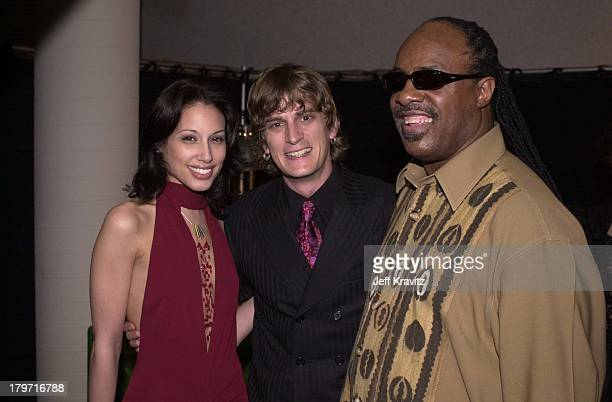 Rob Thomas and wife with Stevie Wonder during QVC Grammy