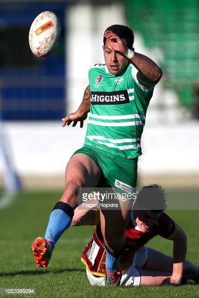 Rob Thompson of Manawatu kicks ahead in the tackle of evade Rory van Vugt of Southland during the round nine Mitre 10 Cup match between Manawatu and...