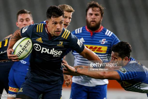 Rob Thompson of the Highlanders fends off EW Viljoen of the Stoemers during the round 10 Super Rugby match between the Highlanders and the Stormers...