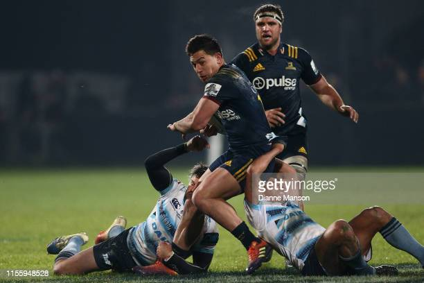 Rob Thompson of the Highlanders is tackled by Adam Ashley-Cooper and Nick Phipps of the Waratahs during the round 18 Super Rugby match between the...