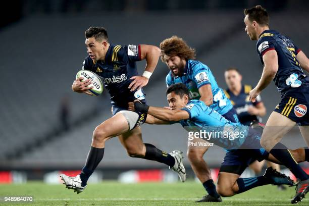 Rob Thompson of the Highlanders is tackled during the round 10 Super Rugby match between the Blues and the Highlanders at Eden Park on April 20 2018...