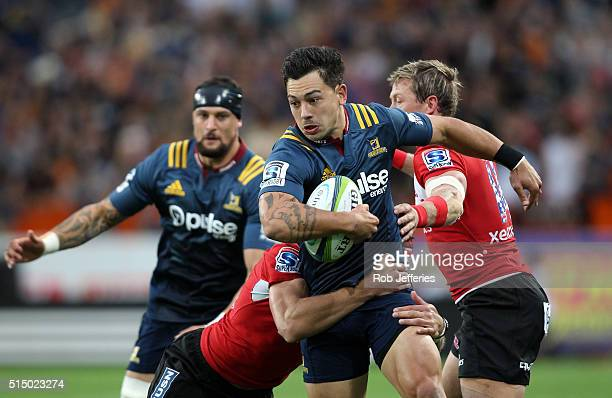 Rob Thompson of the Highlanders looks to ust the Lions defence during the round three Super Rugby match between the Highlanders and the Lions at...