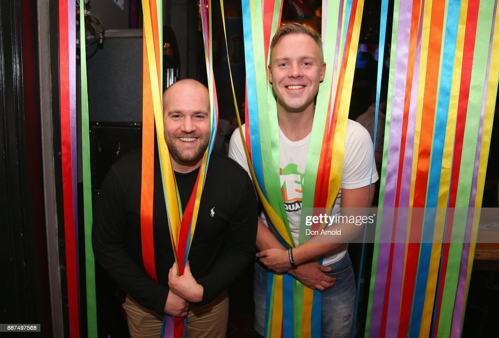 Rob Tollan and Andrew Killen pose inside the Stonewall Hotel on December 7, 2017 in Sydney, Australia. The historic bill was passed on the final day of parliamentart sitting for 2017. The legislation means same-sex couples will now be able to be legally married in Australia. Australians voted 'Yes' in the Marriage Law Postal Survey for the law to be changed in November.