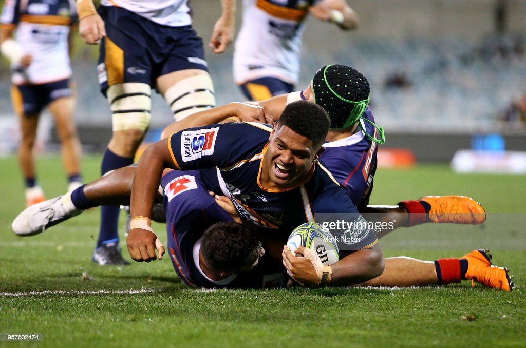 Rob Valetini of the Brumbies crashes over to score a try during the round 12 Super Rugby match between the Brumbies and the Rebels at GIO Stadium on May 12, 2018 in Canberra, Australia.