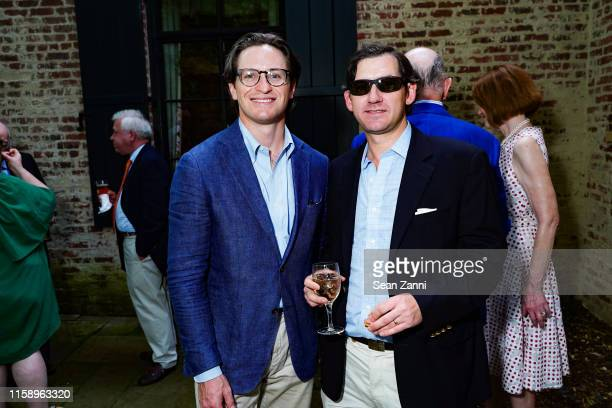 Rob Walsh and Clifton Teagle attend A Country House Gathering To Benefit Preservation Long Island on June 28 2019 in Locust Valley New York