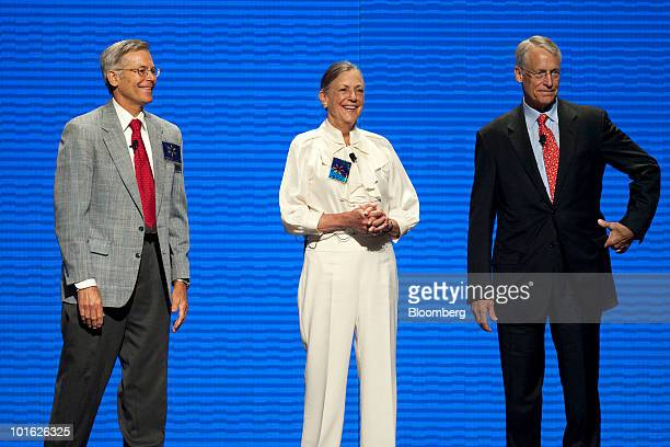 Rob Walton chairman of WalMart Stores Inc and son of WalMart founder Sam Walton right stands on stage with his siblings Alice Walton center and Jim...