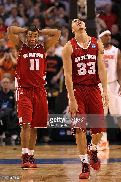 Rob Wilson and Jordan Taylor of the Wisconsin Badgers react late in the game against the Syracuse Orange during their 2012 NCAA Men's Basketball East...