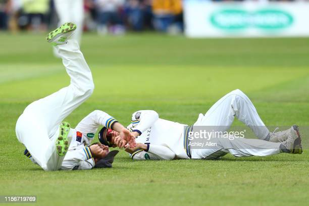 Rob Yates of Warwickshire CCC is dropped in the slips by Adam Lyth of Yorkshire CCC teammate Tom KohlerCadmore attempts to catch the rebound during...