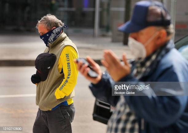 Rob Young left and Joseph McCarthy observe One Boston Day the sevenyear anniversary of the Boston Marathon Bombings April 15 2020 in Boston at the...